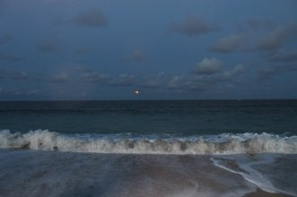 Orange moon rise on ocean