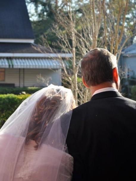 bride-leaning-on-groom-in-doorway