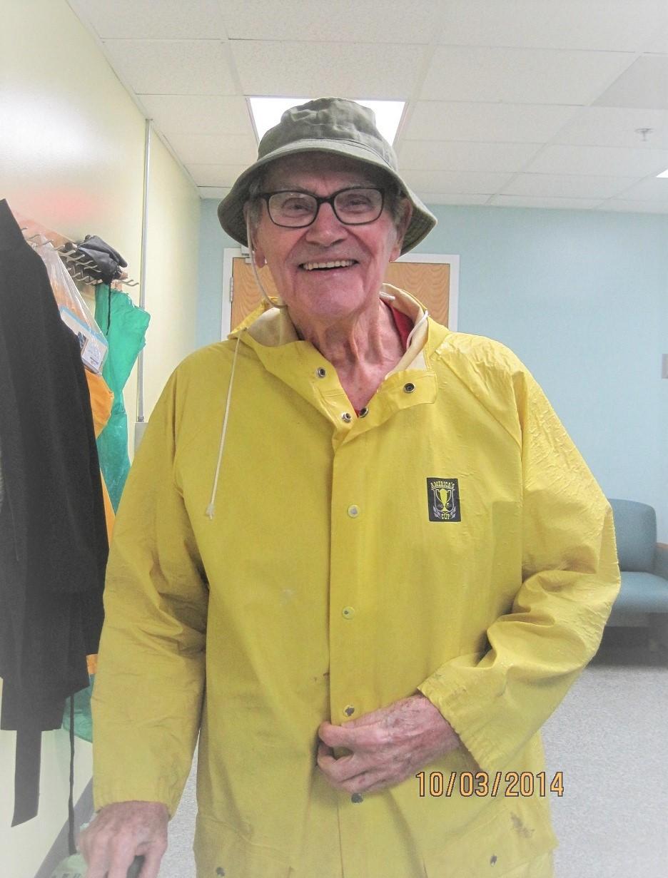 Dad in raincoat at rehab (2)