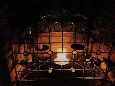 candle in fireplace