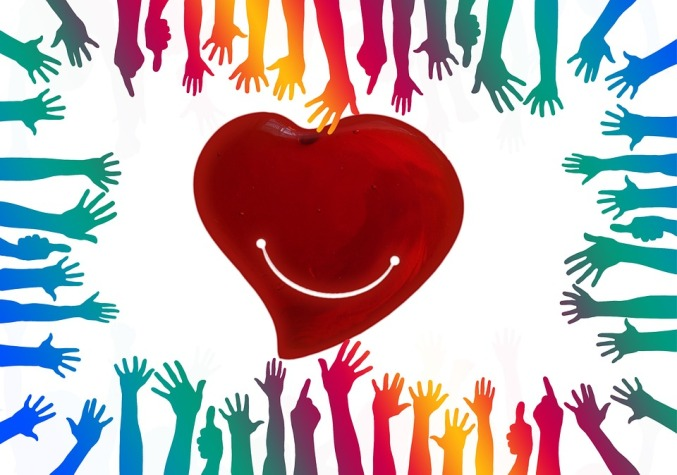 hands reaching to heart