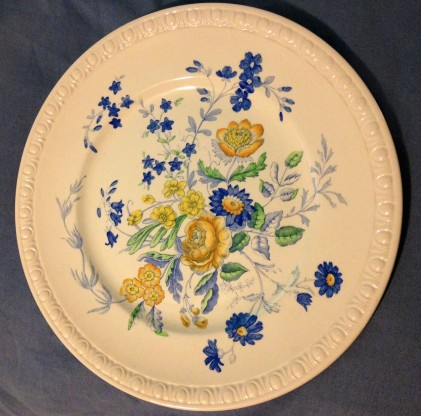 blue and yellow flowered plate