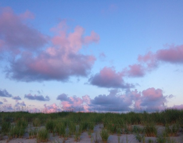 clouds in pnk over dunes