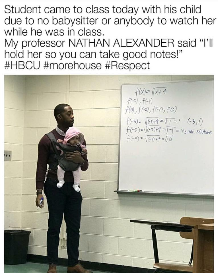 Teacher holds baby for student