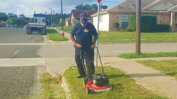 bus driver cuts grass GNT