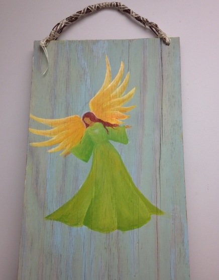 Angel in a green dress on white